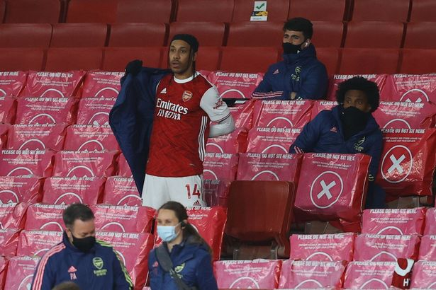 Arsenal's Pierre-Emerick Aubameyang (C) reacts after being substituted during the Liverpool loss