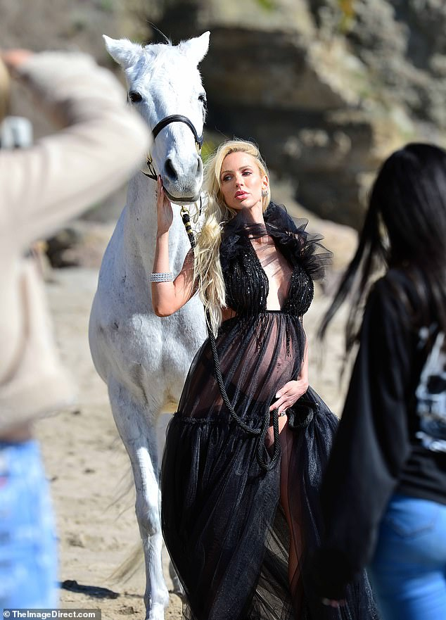 Horsing around: Selling Sunset's Christine Quinn was all about drama during a Malibu maternity shoot last Thursday