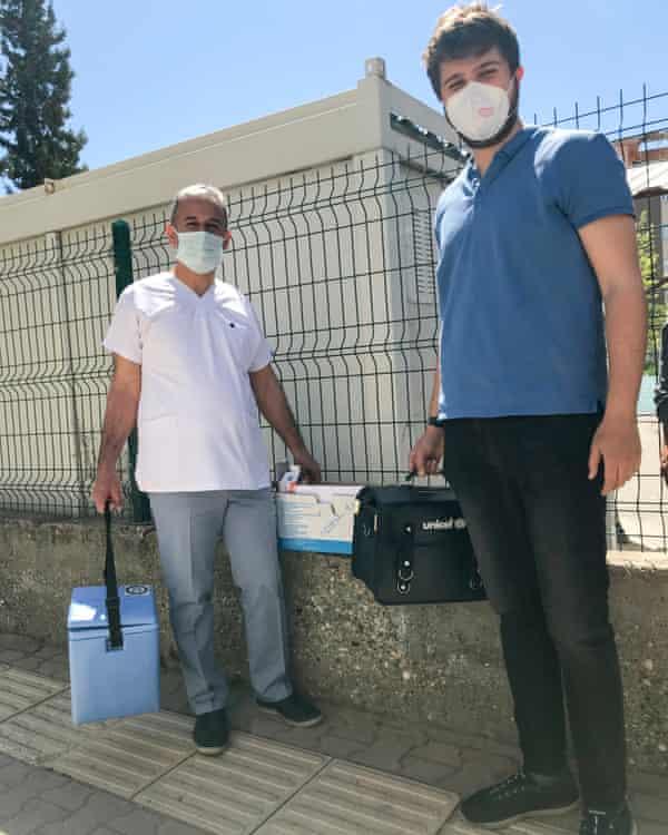 Health workers gear up for a day of door-to-door 'vaccination persuasion'.