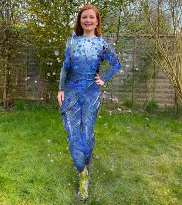 Hannah Marriott in her back garden, 'wearing' an Auroboros bodysuit and Shishigami shoes.