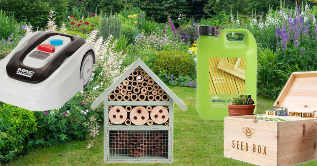 (l-r) MacAllister MRM250 Cordless Robotic lawnmower, Insect House, Decking Cleaner, Wooden Seed Box on a background of a cottage garden