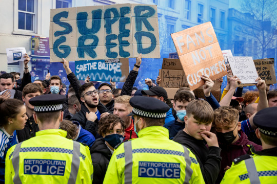 Fans of Chelsea Football Club protest against the European Super League outside Stamford Bridge