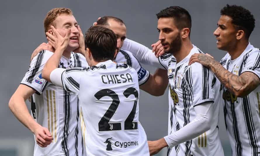 Dejan Kulusevski (left) is mobbed by his Juventus teammates after opening the scoring.