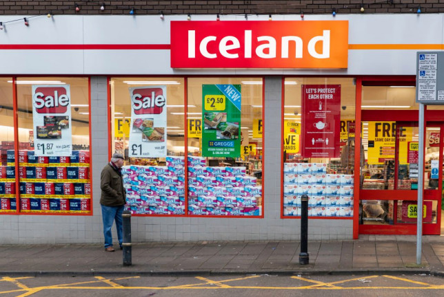 A man walks past the Iceland supermarket in Wales.