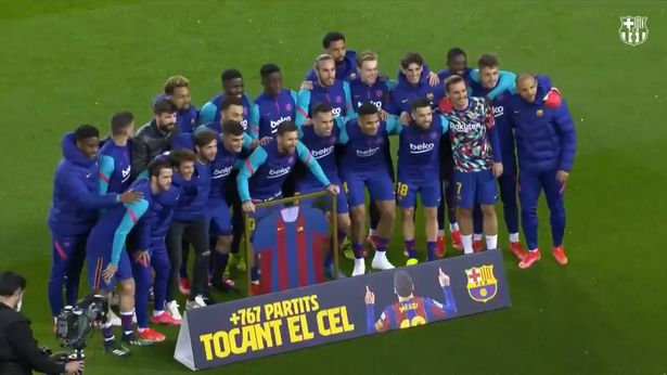 Barcelona players celebrate Messi's milestone achievement with the club.