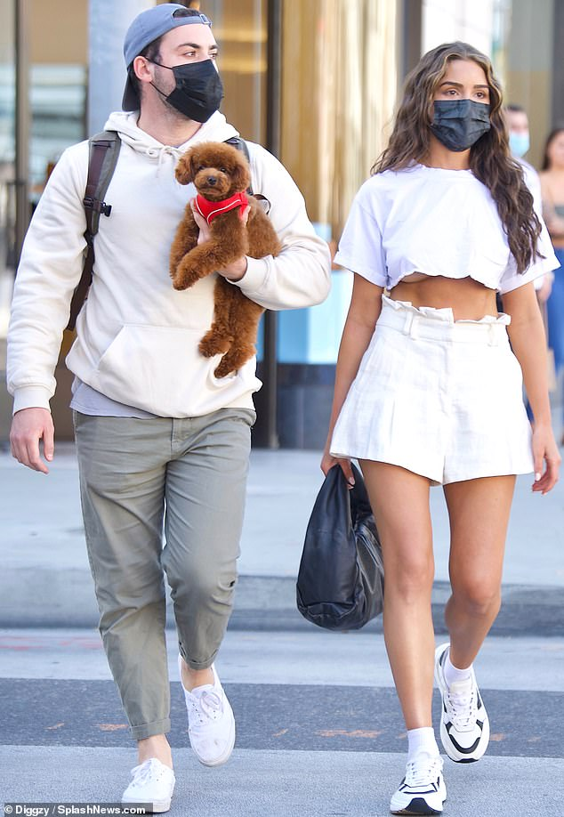 On the go:Olivia Culpo flashed a bit of underboob and showed off her chiseled midriff while surfacing from lockdown in Beverly Hills this week with her dog Oliver Sprinkles