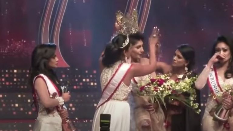 Original Mrs Sri Lanka 2021 winner Pushpika de Silva (C) has her crown removed on stage as she is disqualified over an accusation of being divorced, at a beauty pageant for married women in Colombo. Pic: Colombo Gazette/YouTube