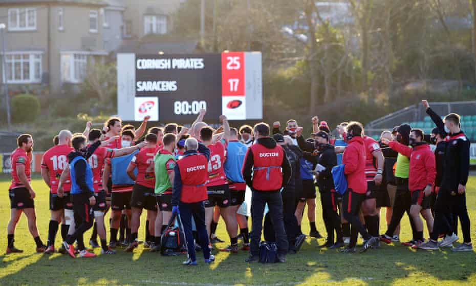 The Cornish Pirates team celebrate their victory against Saracens.
