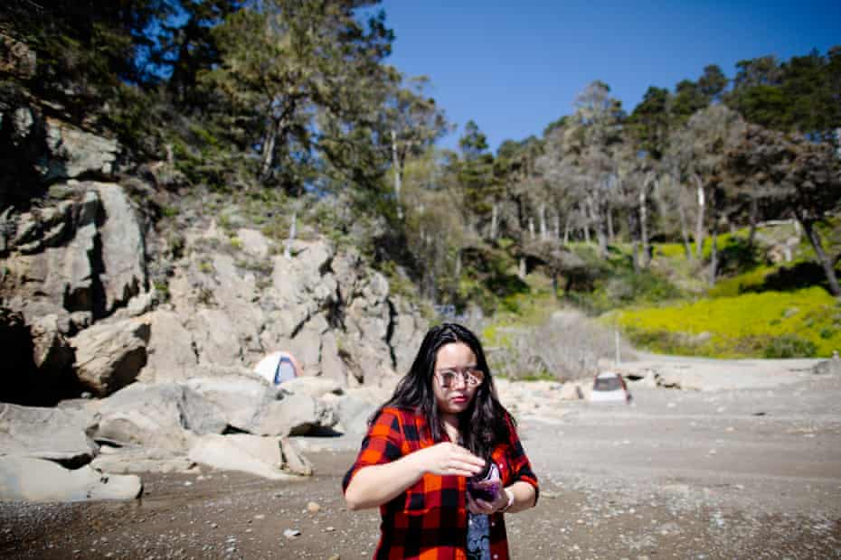 Vivian Ho, Guardian journalist and sea urchin enthusiast, eats a sea urchin at Timber Cove boat landing in Jenner, California.