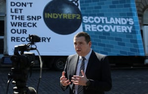 Douglas Ross launching a Scottish Conservative election poster last week.