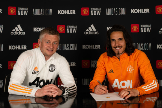 Edinson Cavani of Manchester United poses with Manager Ole Gunnar Solskjaer after signing a contract extension at Aon Training Complex on May 10, 2021 in Manchester, England.