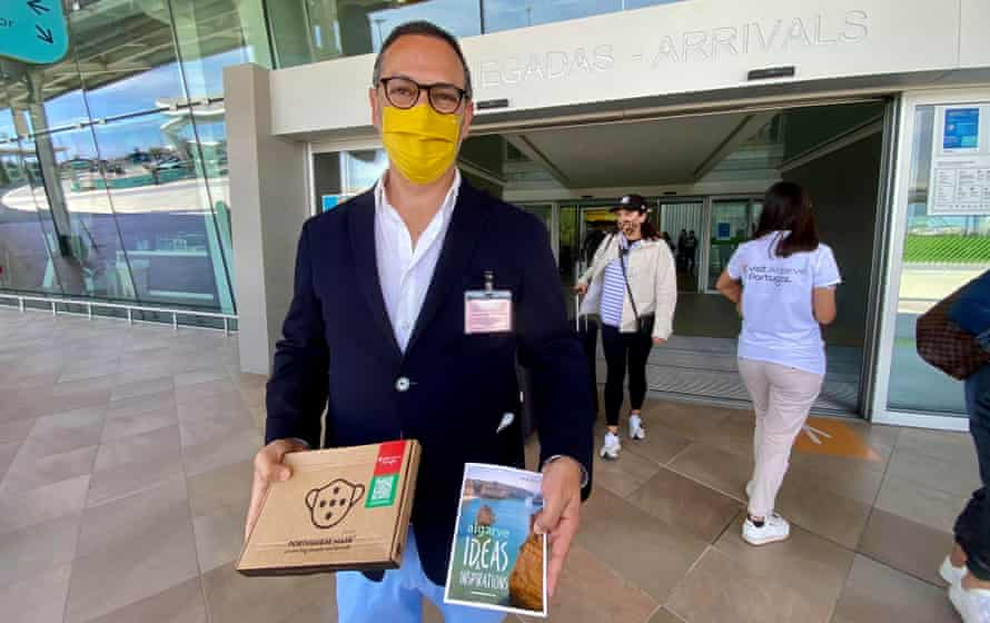 João Fernandes, head of the Algarve tourism, welcomes visitors at Faro airport on Monday.