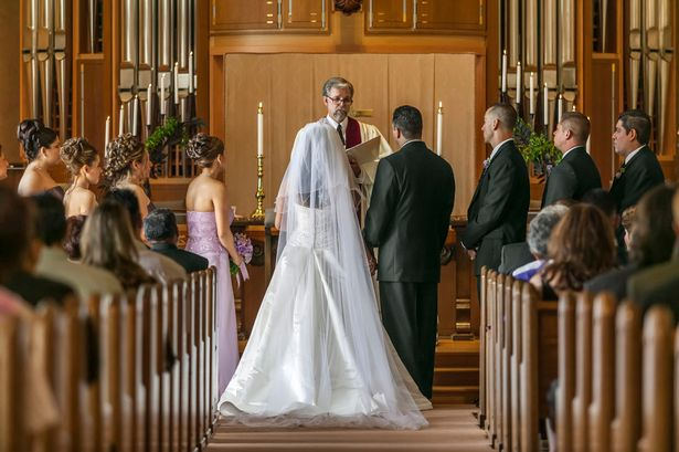 A bride and groom at the alter