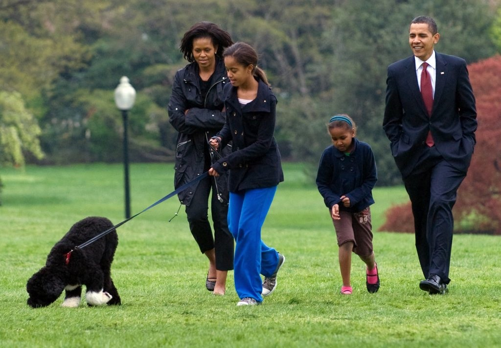 Malia Obama walks her Portuguese water dog, Bo
