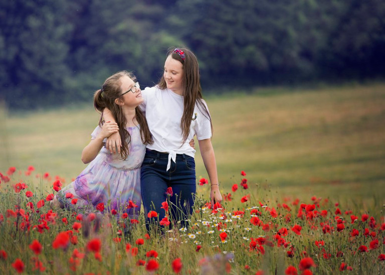 Isla and Poppy Goodall photographed outdoors in red poppy field (Nature Nurture Photography PA Real Life)