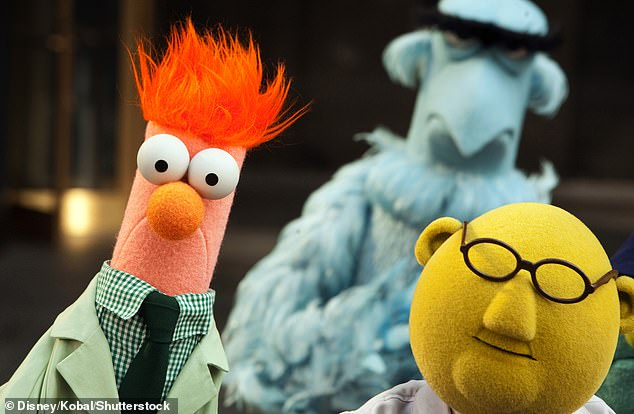 Beaker (left) next to his fellow researcherDr Bunsen Honeydew withSam the Eagle in the background, in a shot from The Muppets (2011)