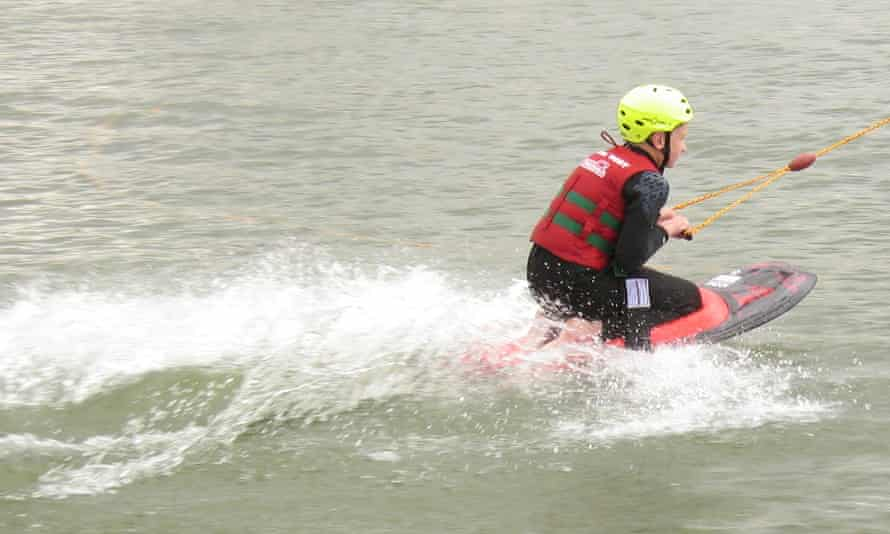 Child kneeboarding at Sheffield Cable and Waterski Park.