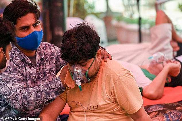 B.1.617 accounts for at least 2% of COVID-19 infections in India and is believed to be partially responsible for the surge that saw 412,262 cases recorded on Thursday. Pictured:A COVID-19 patient breathes with the help of oxygen in Ghaziabad, India, May 6