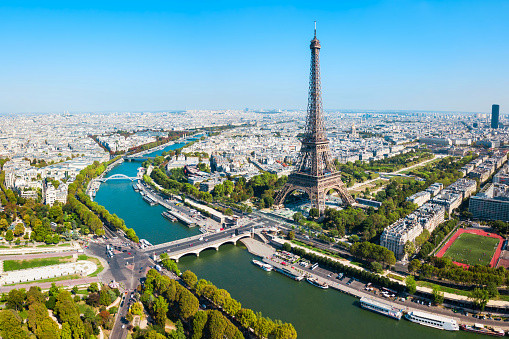 An aerial view of the Eiffel Tower in Paris on a sunny day.
