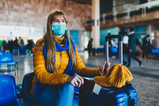 Woman wearing a face mask at the airport