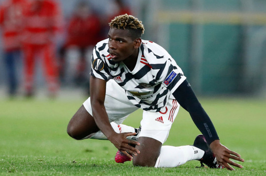 Paul Pogba of Manchester United looks on during the UEFA Europa League Semi-final Second Leg match between AS Roma and Manchester United at Stadio Olimpico on May 6, 2021 in Rome, Italy. Sporting stadiums around Europe remain under strict restrictions due to the Coronavirus Pandemic as Government social distancing laws prohibit fans inside venues resulting in games being played behind closed doors.