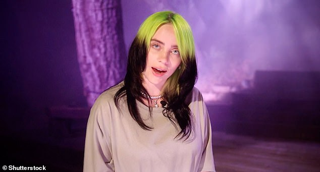 Former look:The 19-year-old singer, shown in August 2020, debuted a new blonde look in March after becoming a pop star with black-and-slime-green hair