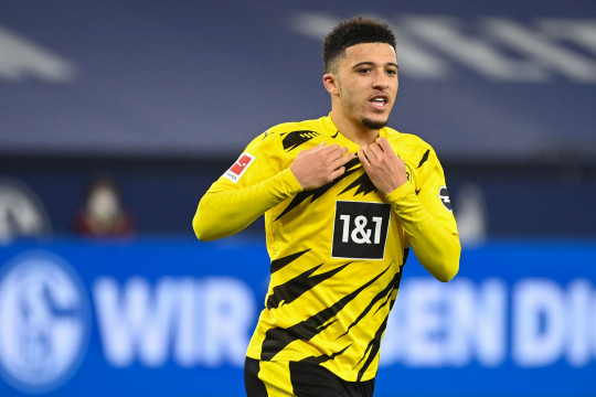 Dortmund's English midfielder Jadon Sancho celebrates scoring the opening goal during the German first division Bundesliga football match FC Schalke 04 vs Borussia Dortmund