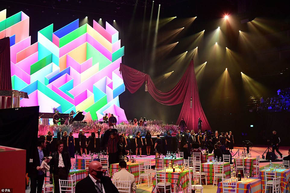 Spaced out: Tables for celebrities inside the venue were spaced out with clear social distances between all the stars