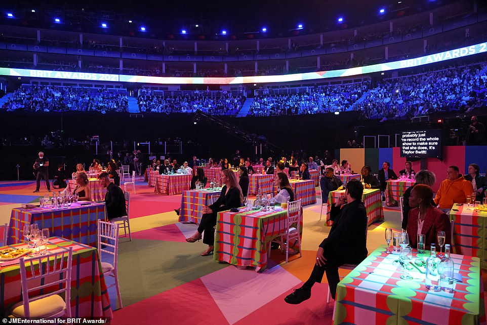 Inside:Attendees were asked to adhere to social distancing rules in the queuing areas outside the O2 arena but once inside the venue, social distancing was not required - although the celebrities' tables appeared to be spaced out