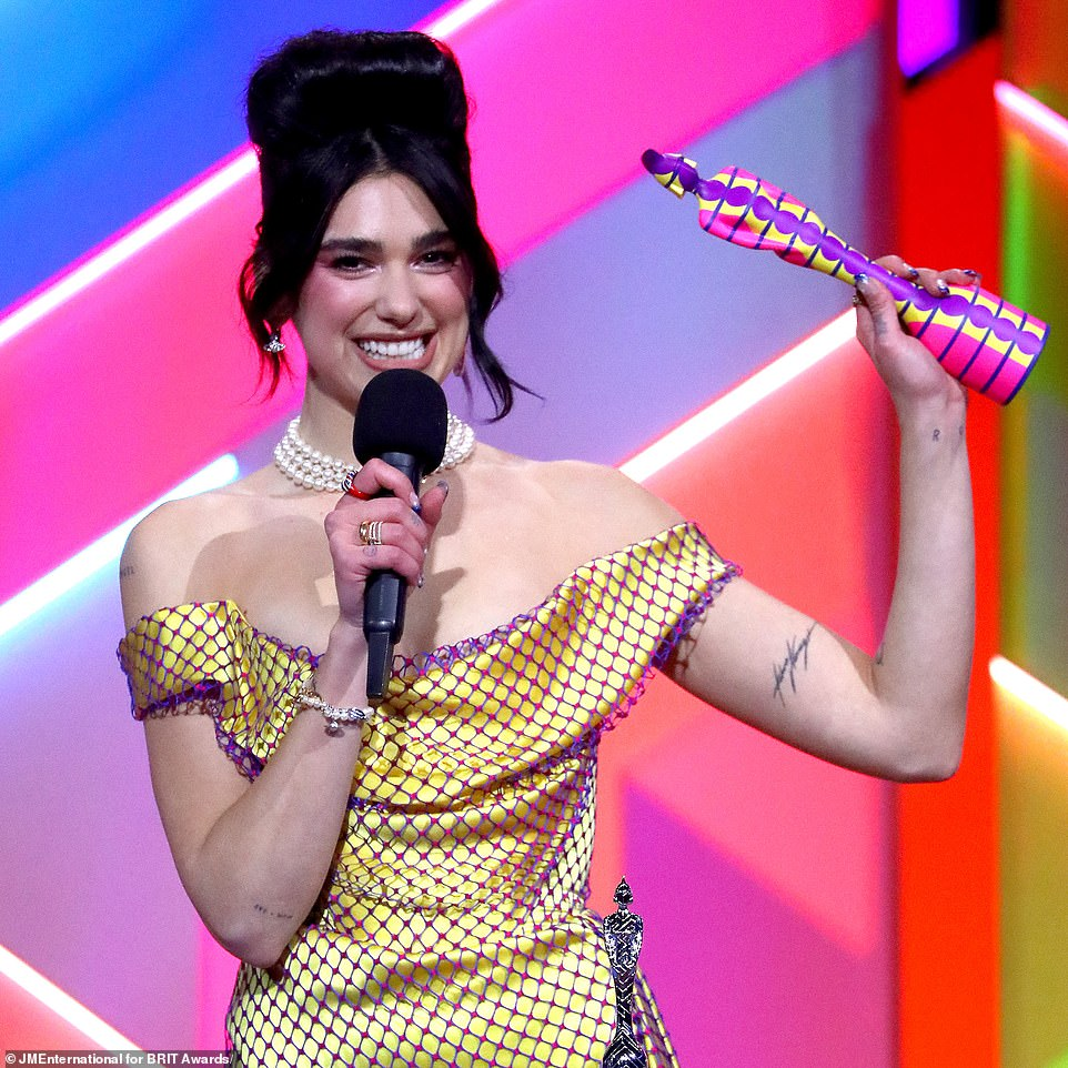 Important:It was a night to remember for Dua as she also took to the stage to accept the award for Female Solo Artist, and used the opportunity to share the prize with nurse Dame Elizabeth Anionwu