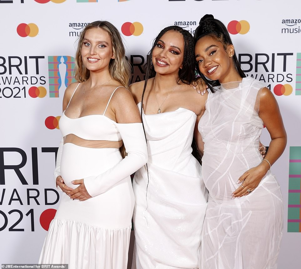 Glowing: The trio coordinated in glamorous white ball gowns, with the two mums-to-be cradling their stomachs as they posed for some snaps just days after announcing their pregnancies
