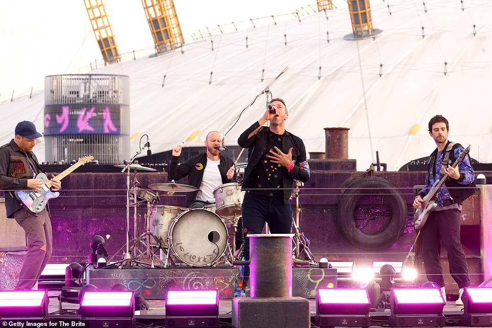 Incredible:Going all out for the opening act, Coldplay opted for futuristic dancing holograms and sparkling fireworks for the showcase, which was filmed outside the O2 last month