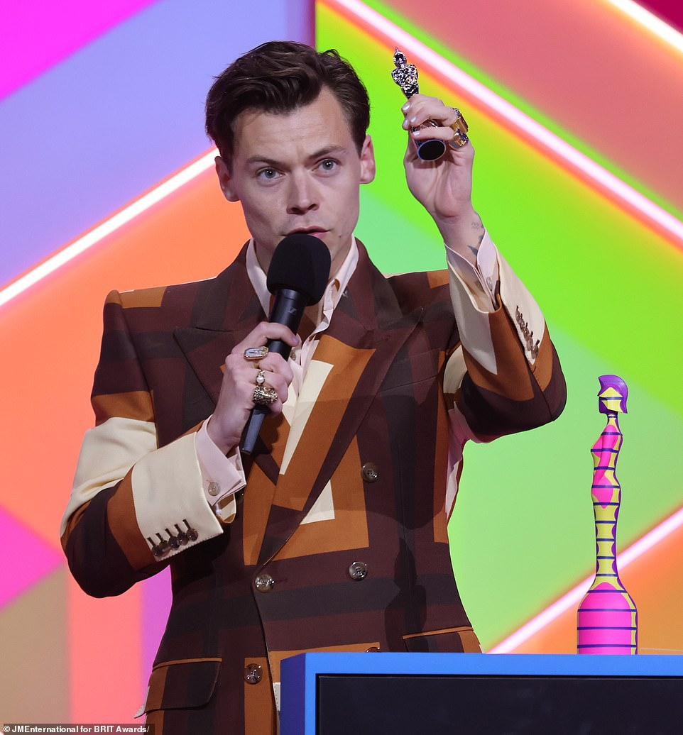 Over the moon: He said: 'I'm really happy and proud to be celebrating British music tonight, I want to thank my fans for being so generous to me always and everyone who has my back thank you so much'