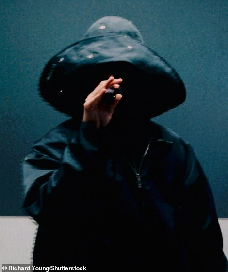 Covered up: The Canadian musician, real name Abel Tesfaye, could barely visible, covering his face with a wide-brimmed hat