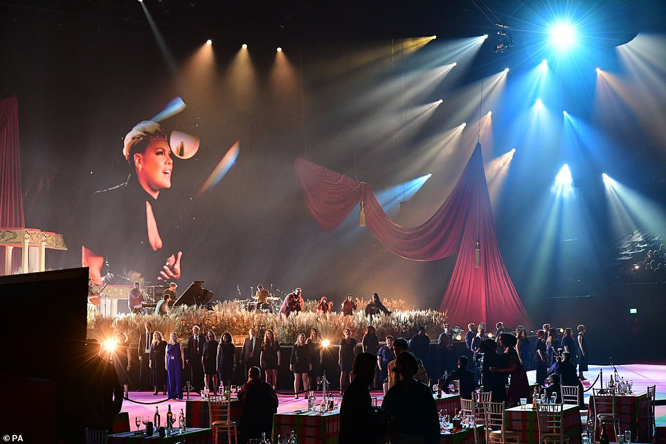 Voices in unison: A sizeable choir accompanied the stars as they closed out the star-studded ceremony in memorable style