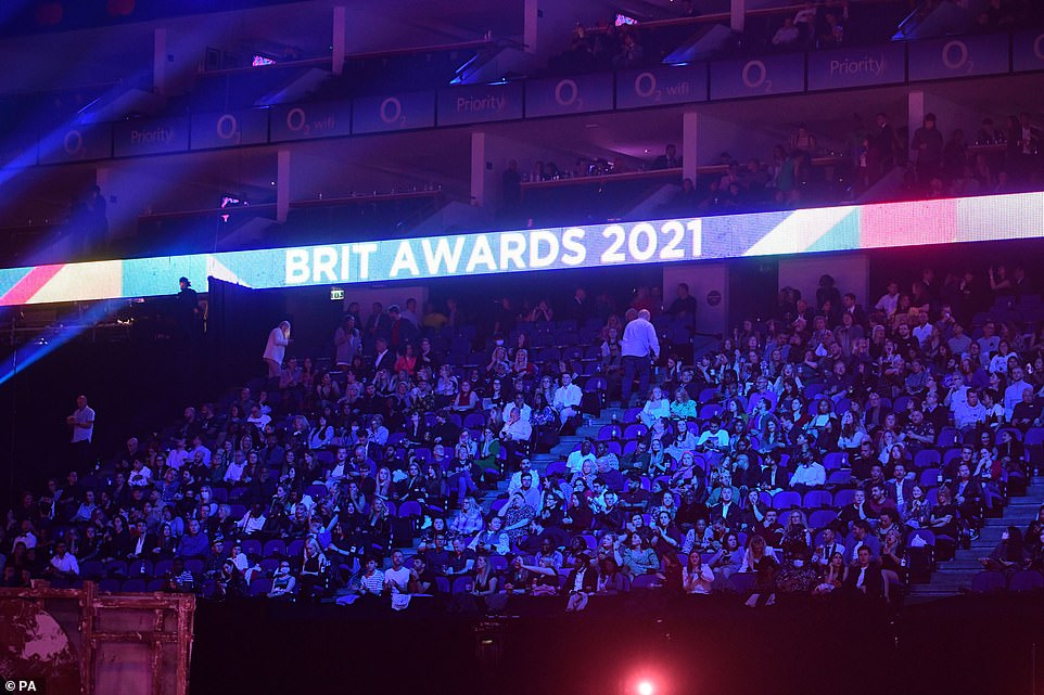Look how close they are!The 2021 Brit Awards marked the first major indoor music event in over a year as bosses released 2,500 free tickets to key workers