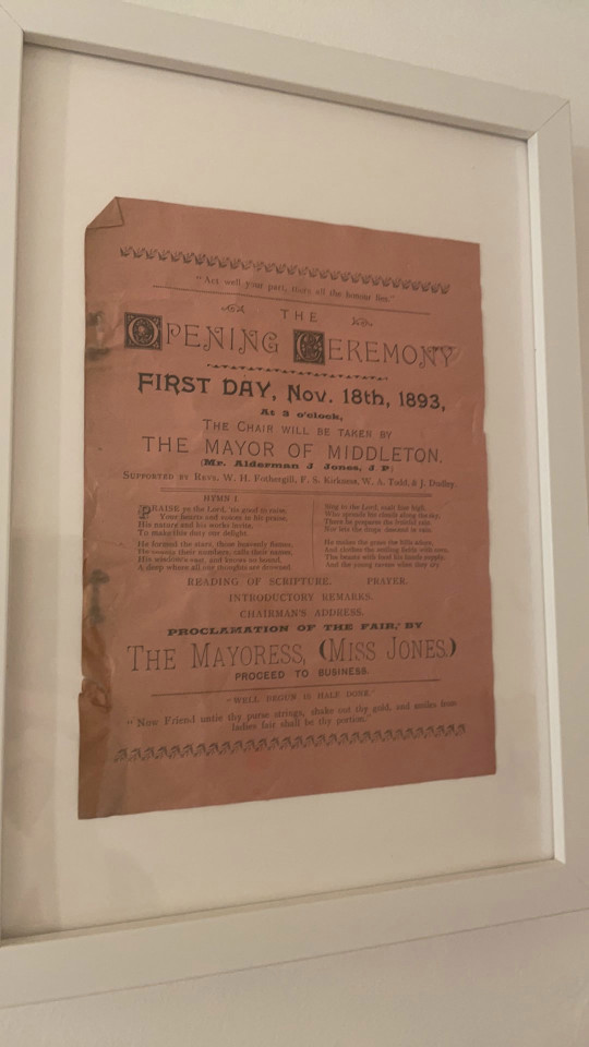 Information on the church first being opened that Emily Barratt has framed and mounted on the wall