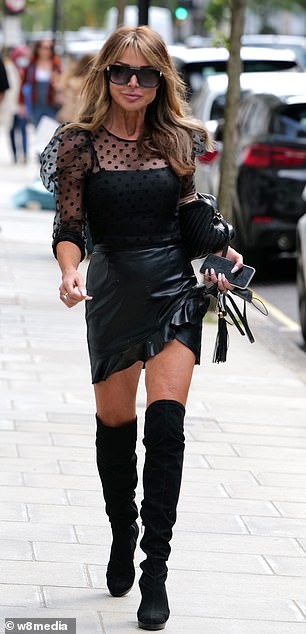 Fashion:The TV personality completed her look for the outing by carrying a black handbag