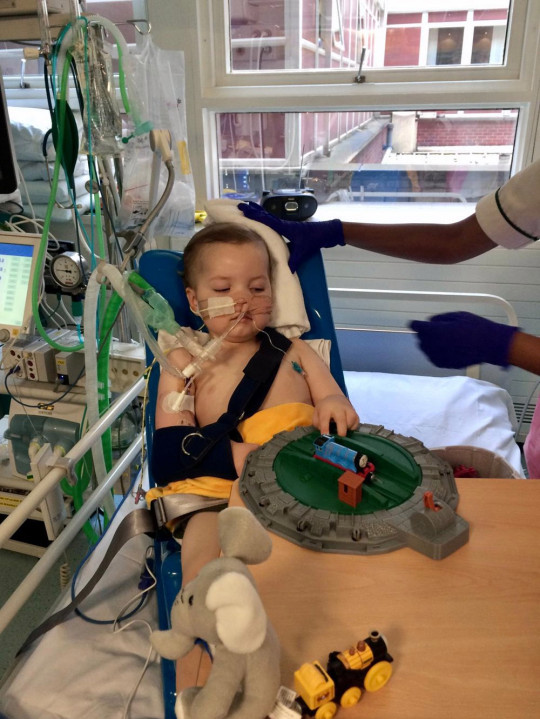 Josh in the PICU playing with his favourite Thomas the Tank Engine trains. PA Real Life Collect