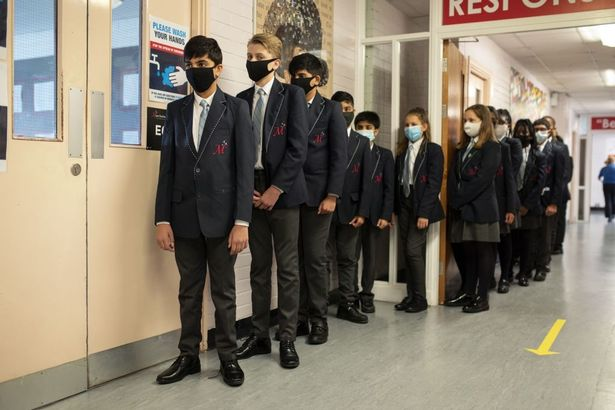 Year eight pupils queue in a corridor at Moor End Academy in Huddersfield