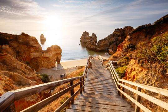 Boardwalk to Camilo beach at sunrise, Lagos, Algarve, Portugal