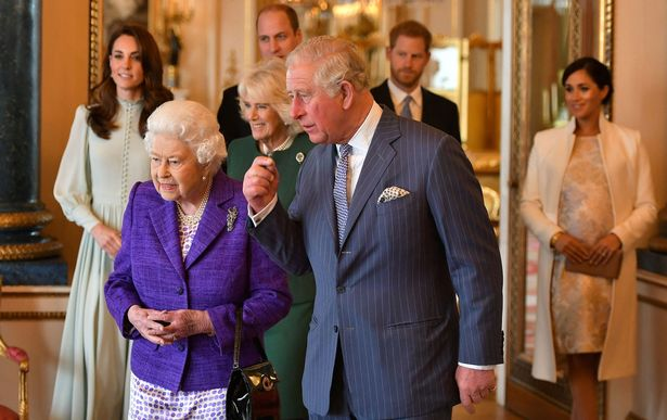 Prince Charles, Prince of Wales (C) walks with his mother Britain's Queen Elizabeth II (2L), and his wife Britain's Camilla, Duchess of Cornwall (3L), and his sons and their wives, Britain's Prince William, Duke of Cambridge (4L) and Britain's Catherine, Duchess of Cambridge (L), and Britain's Prince Harry, Duke of Sussex, (2R) and Meghan, Duchess of Sussex (R) during a reception to mark the 50th