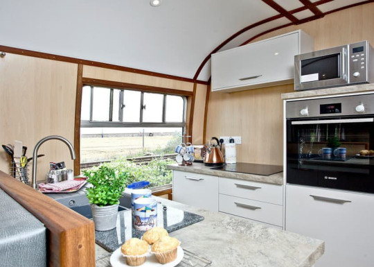 Stay in a converted train carriage by the beach in Devon for your next UK holiday