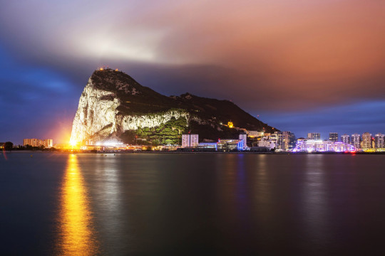 Gibraltar is a British overseas territory, located at the southern end of the Iberian Peninsula