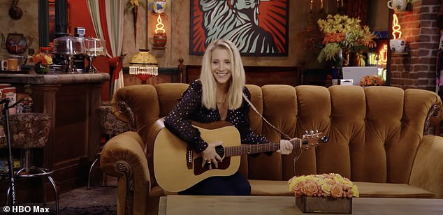 Back in action: Phoebe Buffay was back at her old stomping grounds as she strummed a guitar while sitting on the couch at the group's favorite coffee house, Central Perk