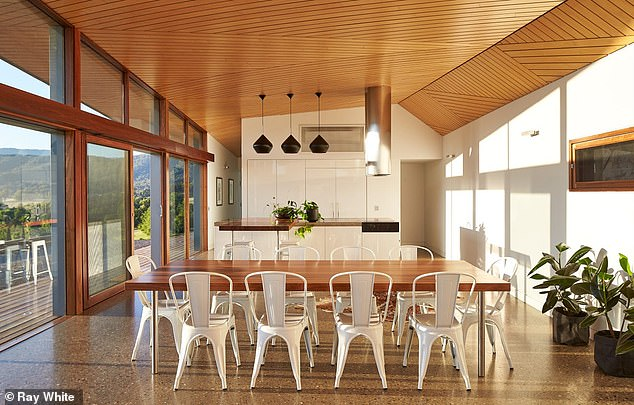 Bright:The west wing of the home combines the kitchen, dining and living areas together