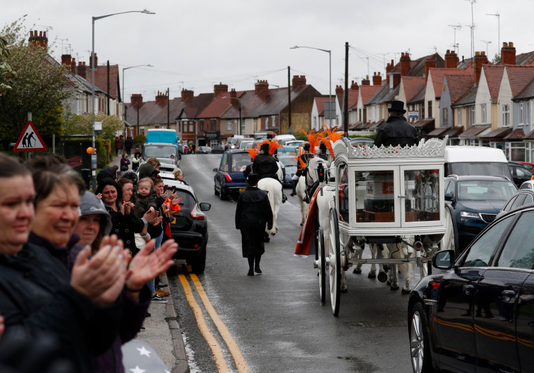 People applaud as the funeral cortege of Azaylia Cain leaves the family home.
