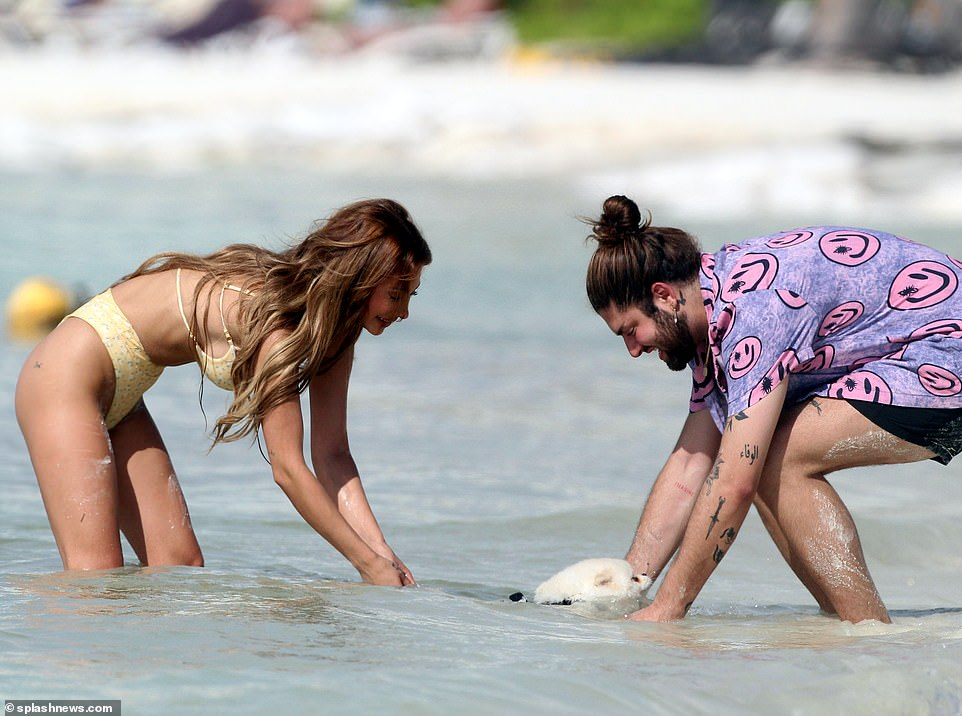 Doting mom: Francesca was seen giving her dog words of affirmation after she expertly doggy paddled in the water