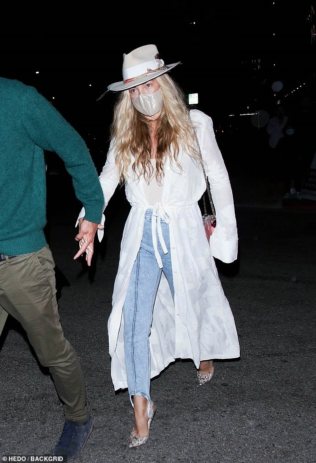 Boho: Meanwhile, Hudson showcased her famous boho chic fashion sense in a pair of high-waisted light wash jeans