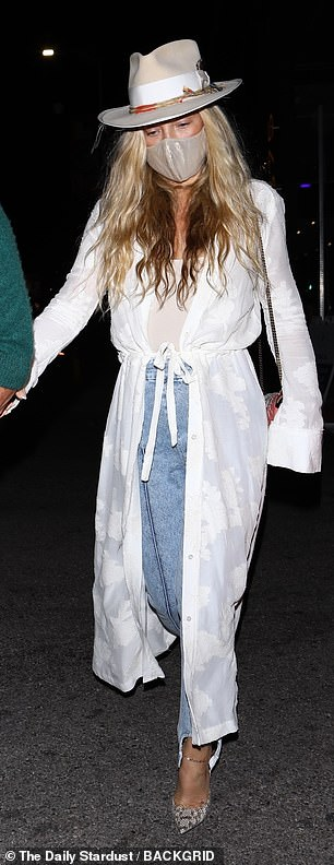 Signature: The 42-year-old actress' signature golden strands flowed out from beneath an off white fedora hat with suede trim